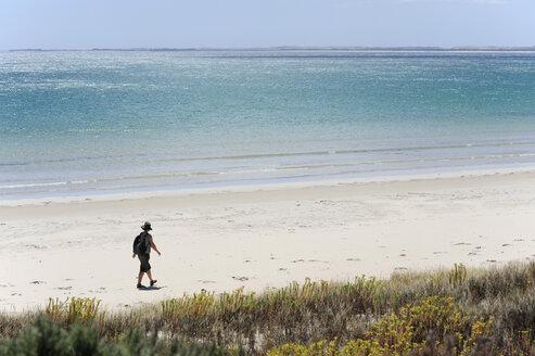 Australia, South Australia, Robe, woman walking on the beach - MIZ000552
