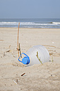 Belgium, empty plastic bottle lying on sandy beach at North Sea coast - GW003128