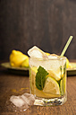 Glass of home made lemonade splash with slices of lemon - CSTF000370