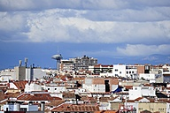 Spain, Madrid, historic city center, view over the roofs of Malasana towards the Faro de Moncloa - MIZ000597