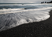 Iceland, South of Iceland, Beach of Vik i Myrdal with Reynisdrangar in the background - MKFF000088