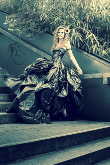 Woman wearing dress made from bin bags - FC000415