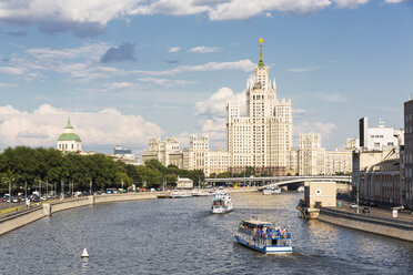 Russia, Central Russia, Moscow, Moskva river and excursion boats, Seven Sisters in the background - FOF006814