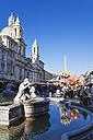 Italy, Lazio, Rome, Piazza Navona, Sant Agnese in Agone, Fontana dei Quattro Fiumi and Christmas market - GWF003140