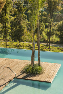 Morocco, Fes, view to swimming pool with wooden boardwalk of a hotel - KM001348