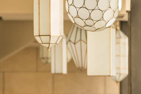 Morocco, Fes, lighted ceiling lamps in a hotel - KM001396