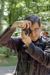 Netherlands, Holland, Keukenhof, Visitor photographing - HLF000736