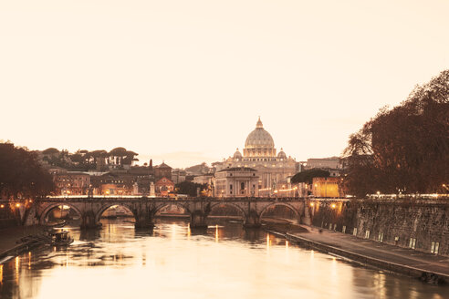 Italy, Rome, St. Peter's Basilica and Ponte Sant'Angelo in the evening - GW003117