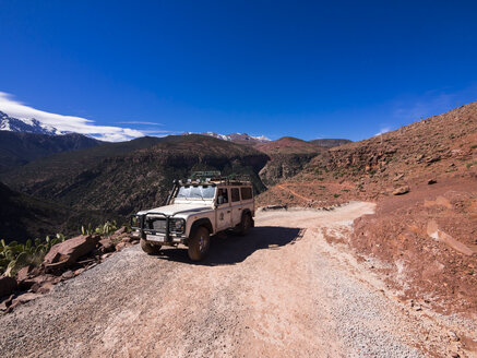 Morocco, Marrakesh-Tensift-El Haouz, Atlas Mountains, Ourika Valley, Landrover on gravel road - AM002713