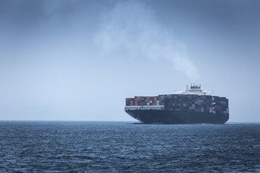 Spain, Andalusia, Tarifa, Cargo ship - KBF000115