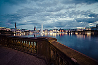 Germany, Hamburg, Inner Alster and Alster fountain in the evening - KRPF001019
