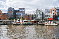 Germany, Hamburg, HafenCity, Sandtorhafen, Sandtor harbour and modern residential buildings - KRP001003