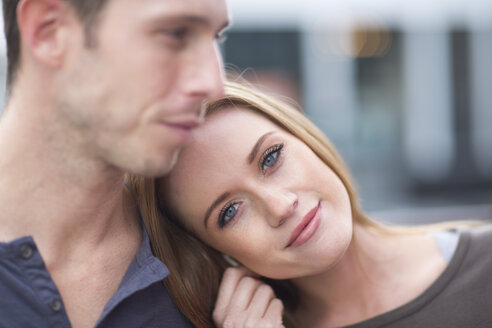 Portrait of happy young woman with head on shoulder of her boyfriend - ZEF000035
