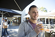 Portrait of smiling man with a soft drink - ZEF000110