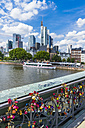 Germany, Hesse, Frankfurt, Love locks at bridge Eiserner Steg, Financial district in the background - AM002731