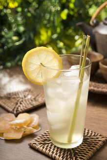 Ginger lemon tea in a glass with fresh lemongrass, candied ginger - CSTF000389