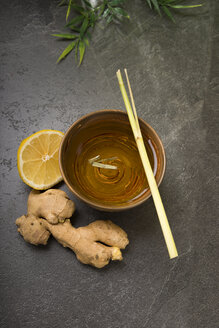 Ginger lemon tea in a tea bowl with fresh lemongrass and ginger - CSTF000391