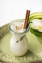 Chai Latte Iced tea in a glass with cinnamon stick and vanilla pod - CSTF000399