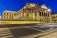 Austria, Vienna, view to state opera house at twilight with driving tramway in the foreground - EJWF000494