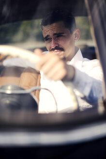 Young man inside vintage car - VRF000113