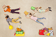 Children with heaps of birthday presents - BAEF000976