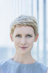 Portrait of smiling blond woman - TCF004314