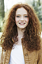 Portrait of smiling girl with curly red hair - GDF000405
