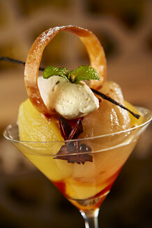 Mango desert with pineapple mousse and star anise in a cocktail glass - KMF001408