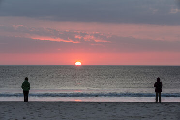 Germany, Schleswig-Holstein, Sylt, sunset on the beach, two people - SRF000779