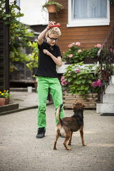 Portrait of boy playing with his dog - PAF000886