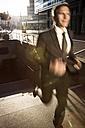 Germany, Berlin, Businessman running on stairs - FKF000618