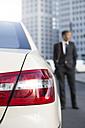 Germany, Berlin, Businessman taking a taxi - FKF000624