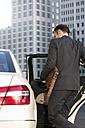 Germany, Berlin, Businessman taking a taxi - FKF000640