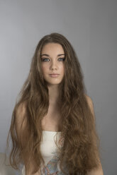 Portrait of teenage girl with long brown hair - GD000433