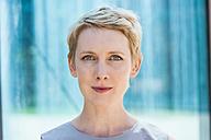 Portrait of staring blond woman - TCF004447