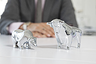 Bull and bear figurines on a desk - RBF001831