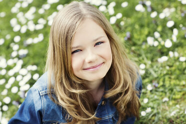 Portrait of smiling girl on flower meadow - GDF000413