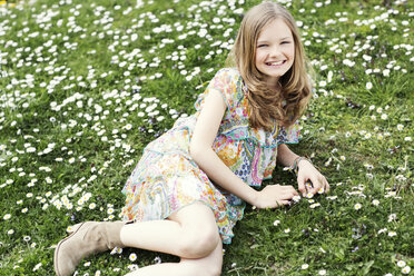 Girl lying on flower meadow - GDF000415