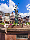 Germany, Hesse, Frankfurt, view to half-timbered houses at Roemerberg with fountain of justice in the foreground - WDF002586