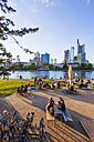 Germany, Hesse, Frankfurt, skyline of financial district and people at River Main - WD002627