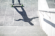 Shadow of a skate boarder on pavement - ZEF000767