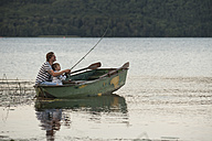 Germany, Rhineland-Palatinate, Laacher See, father and son fishing from boat - PAF000915