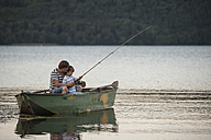 Germany, Rhineland-Palatinate, Laacher See, father and son fishing from boat - PAF000916
