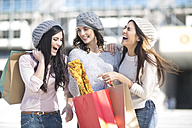 Three female friends with wool caps and shopping bags - ZEF000794