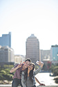 Happy young couple taking a selfie with smartphone - ZEF000810