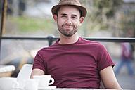 Portrait of relaxed man having a coffee break - ZEF000325