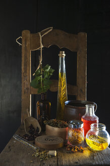 Dried herbs and oil bottles - HHF004923
