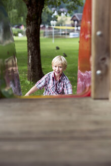 Portrait of little boy having fun on a playground - DAWF000134
