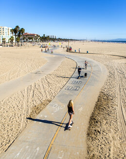 USA, California, Santa Monica, view to skate boarders on the bike path from above - JLR000008