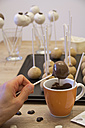 Woman preparing cake pops - YFF000238
